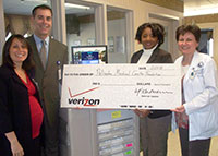 Verizon Presents PMC with $10,000 Check
